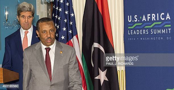 Secretary of State John Kerry follows Prime Minister of Libya Abdullah al-Thinni after delivering remarks to the media regarding their private...