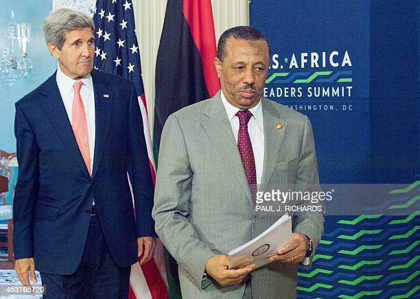 Secretary of State John Kerry follows Prime Minister of Libya Abdullah al-Thinni as they depart after delivering remarks to the media regarding their...
