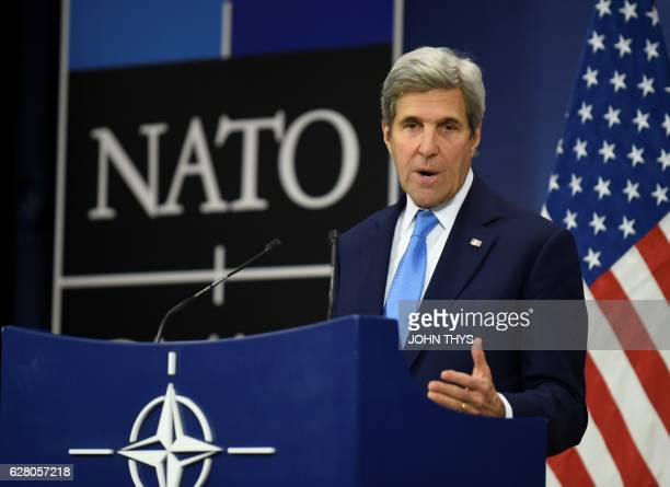 US Secretary of State John Kerry gestures as he give a press conference during a Foreign Affairs meeting at the NATO headquarters in Brussels on...