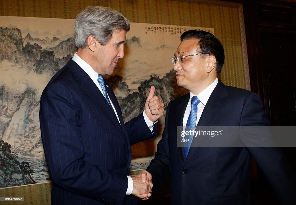 US Secretary of State John Kerry (L) gestures while shaking hands with China's Premier Li Keqiang during a meeting at the Zhongnanhai compound in Beijing on April 13, 2013. The current situation on the Korean peninsula is at a 'critical time', US Secretary of State John Kerry told Chinese President Xi Jinping on April 13 as he arrived to seek Beijing's intervention in the crisis. AFP PHOTO / POOL / Jason Lee