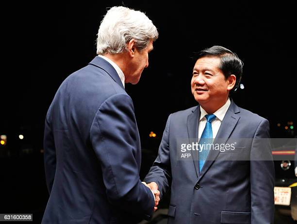 US Secretary of State John Kerry is greeted by Secretary of the Ho Chi Minh City Party Committee Dinh La Thang before their meeting in Ho Chi Minh...