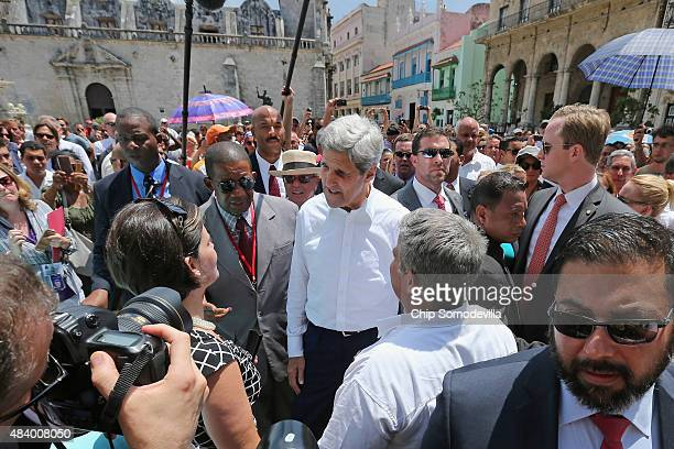 S Secretary of State John Kerry is surrounded by a wall of Cuban and American security agents as he walks through San Francisco Plaza August 14 2015...
