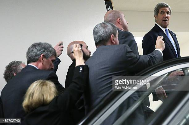S Secretary of State John Kerry is trailed by by reporters while departing a meeting with members of the US Senate on the proposed deal with Iran at...