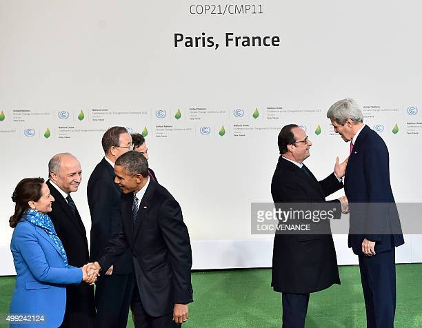 US Secretary of State John Kerry is welcomed by French President Francois Hollande as US President Barack Obama shakes hands with French Minister of...