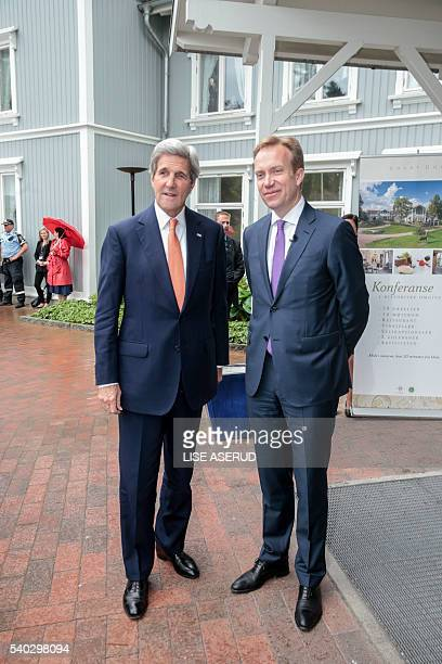 US Secretary of State John Kerry is welcomed by Norway's Minister of Foreign Affairs Borge Brende at the Oslo Forum on June 15 in Oslo Norway Scanpix...
