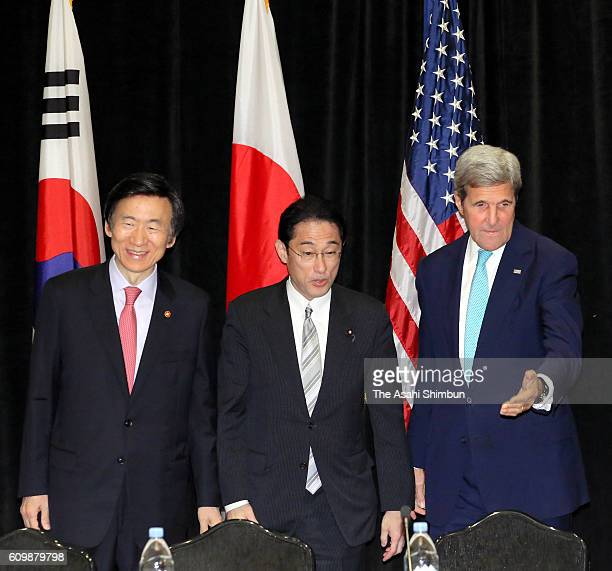 Secretary of State John Kerry , Japanese Foreign Minister Fumio Kishida and South Korean Foreign Minister Yun Byung-se pose for photographs during...