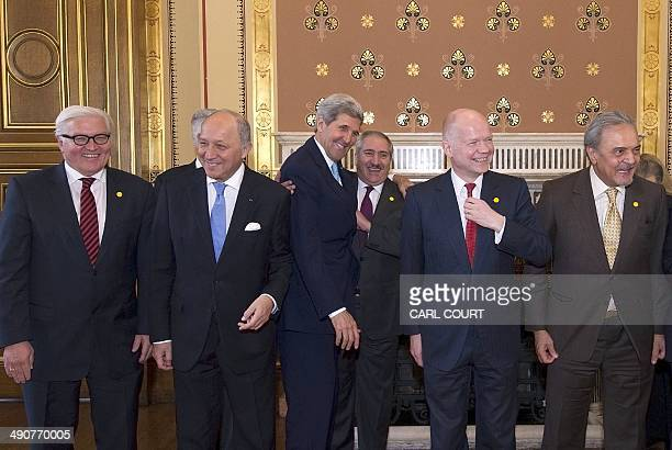 US Secretary of State John Kerry jokes with Jordanian Foreign Minister Nasser Judeh as German Foreign Minister FrankWalter Steinmeier French Foreign...