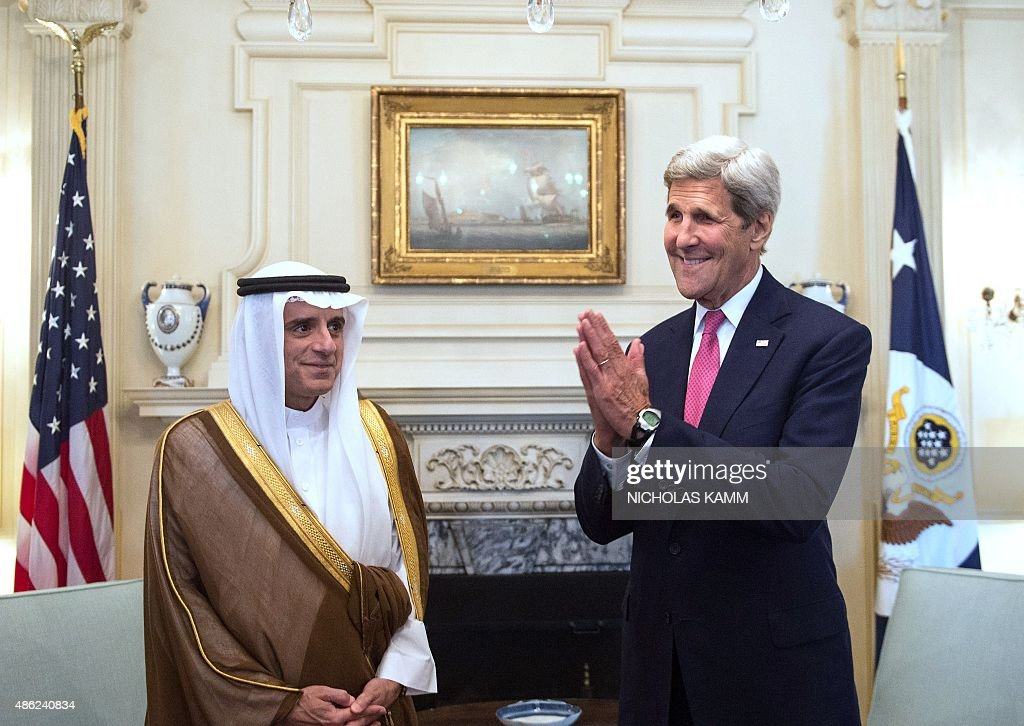 US Secretary of State John Kerry (R) jokes with reporters as he greets Saudi Foreign Minister Adel al-Jubeir prior to talks at the State Department in Washington, DC, on September 2, 2015.