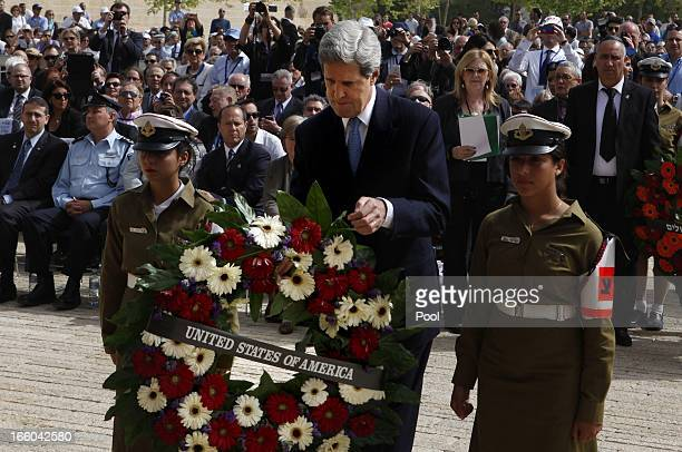 S Secretary of State John Kerry lays a wreath during the annual ceremony for Holocaust Remembrance Day at the Yad Vashem memorial on April 8 2013 in...