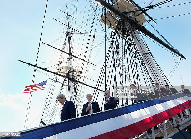 S Secretary of State John Kerry left British Foreign Secretary Philip Hammond third from right and others disembarked after touring the USS...