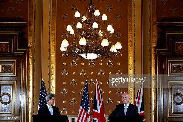 US Secretary of State John Kerry listens as British Foreign Secretary William Hague speaks during a joint press conference at the Foreign and...