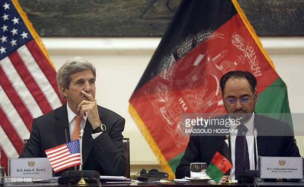 US Secretary of State John Kerry listens on as Afghan Foreign Minister Salahuddin Rabbani speaks during a conference in Kabul on April 9 2016 HOSSAINI