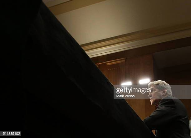 Secretary of State John Kerry listens to comments during a Senate Foreign Relations Committee hearing on Capitol Hill February 23 2016 in Washington...