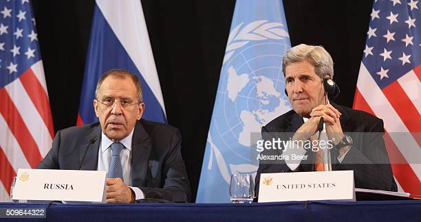 Secretary of State John Kerry listens to Russian Foreign Minister Sergey Lavrov during a press conference following a meeting of the International...