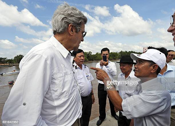 Secretary of State John Kerry listens to Vo Ban Tam who was a member of the former Viet Cong and who took part in the attack on Kerry's Swift Boat on...