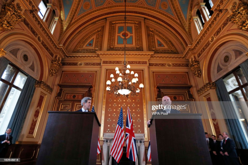 US Secretary of State John Kerry (L) looks on as Britain's Foreign Secretary William Hague (R) speaks during a joint news conference on February 25, 2013 in London, England. Mr Kerry is on an 11-day tour and is due to visit Berlin, Paris, Rome, Ankara, Cairo, Riyadh, Abu Dhabi and Doha.The US Secretary of State is to hold a press conference with Foreign Secretary William Hague in London later today.