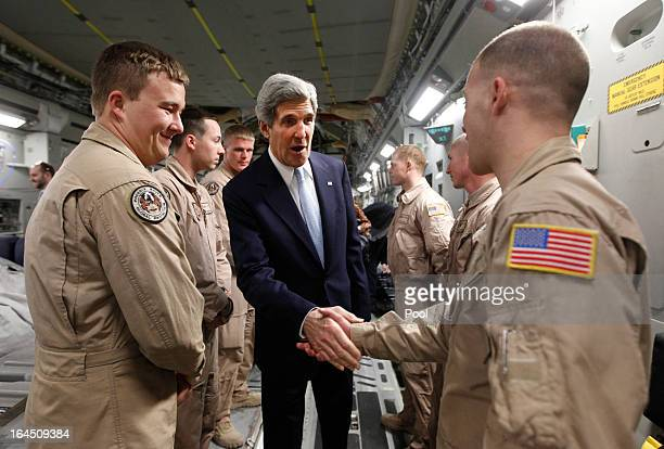 S Secretary of State John Kerry meets with members of the US Air Force 816 Expeditionary Airlift Squadron aboard a C17 aircraft bound for Baghdad on...