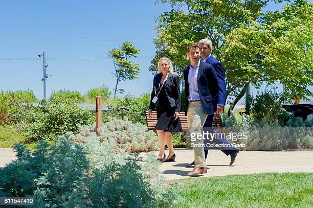 US Secretary of State John Kerry on the rooftop garden at Facebook headquarters with Facebook employees Brenda Tierney and Brian Rice Palo Alto...