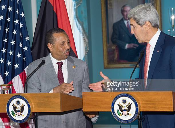 Secretary of State John Kerry reaches out to shake hands with the Prime Minister of Libya Abdullah al-Thinni after delivering remarks at the US...