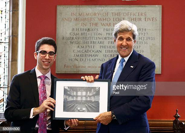 S Secretary of State John Kerry receives a gift of a photograph of the Oxford Union from president Robert Harris after speaking at the Oxford Union...