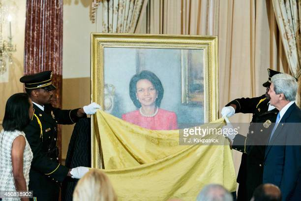 S Secretary of State John Kerry right and former US Secretary of State Condoleezza Rice left watch as Rice's official State Department portrait is...
