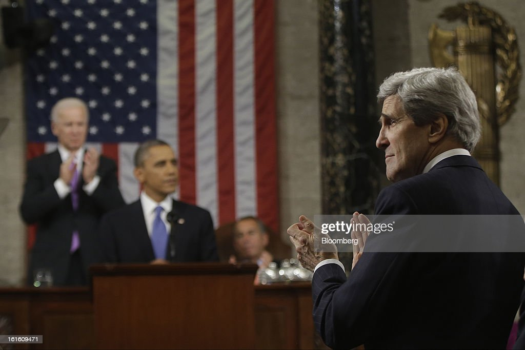 U.S. Secretary of State John Kerry, right, applauds as U.S. President Barack Obama delivers the State of the Union address to a joint session of Congress with U.S. Vice President Joseph 'Joe' Biden, back left, and House Speaker John Boehner, back right, at the Capitol in Washington, D.C., U.S., on Tuesday, Feb. 12, 2013. Obama called for raising the federal minimum wage to $9 an hour and warned he'll use executive powers to get his way on issues from climate change to manufacturing if Congress doesn't act, laying out an assertive second-term agenda sure to provoke Republicans. Photographer: Charles Dharapak/Pool via Bloomberg