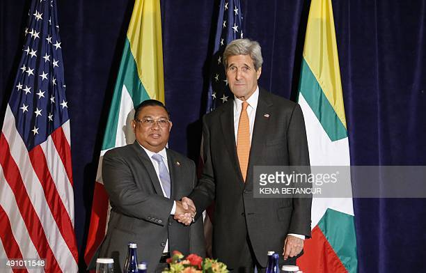 US Secretary of State John Kerry shake hands with Myanmar Foreign Minister Wunna Maung Lwin during meeting on October 2 in New York on the sidelines...