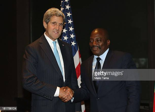 S Secretary of State John Kerry shakes hands at the start of a bilateral meeting with President Joseph Kabila of the Democratic Republic of Congo on...