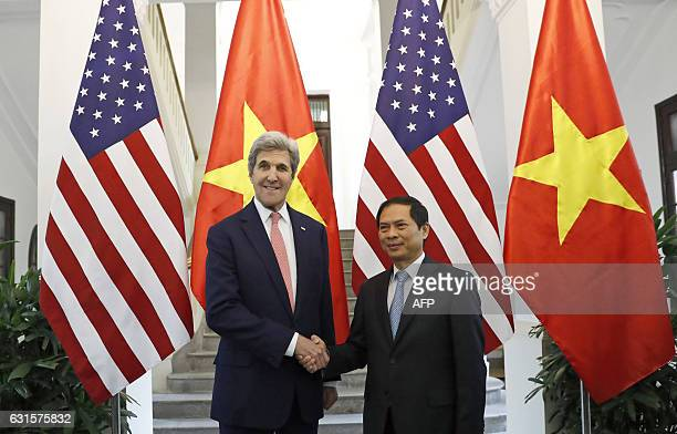 Secretary of State John Kerry shakes hands with Acting Foreign Minister Bui Thanh Son at the Ministry of Foreign Affairs before their meeting in...