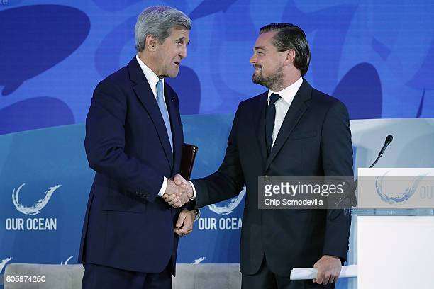 Secretary of State John Kerry shakes hands with actor and environmental activist Leonardo DiCaprio after he announced the launch of the Global...