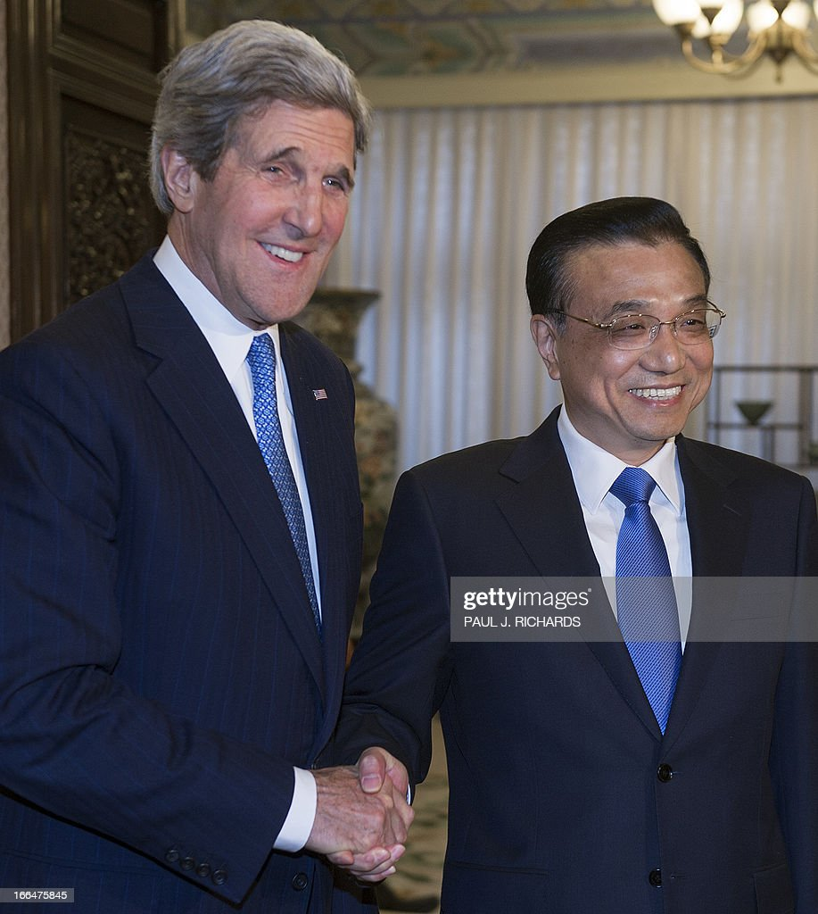 US Secretary of State John Kerry (L) shakes hands with China's Premier Li Keqiang (R) before a meeting at the Zhongnanhai compound in Beijing on April 13, 2013. The current situation on the Korean peninsula is at a 'critical time', US Secretary of State John Kerry told Chinese President Xi Jinping on April 13 as he arrived to seek Beijing's intervention in the crisis. AFP PHOTO / POOL / Paul J. Richards