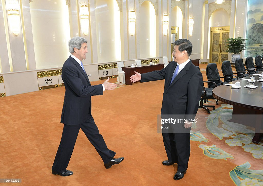U.S. Secretary of State John Kerry (L) shakes hands with Chinese President Xi Jinping before their meeting at the Great Hall of the People in Beijing on April 13, 2013. The U.S. Secretary is on a tour of Asia, visiting South Korea, Japan and China to discuss issues concerning North Korea.
