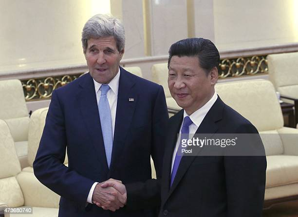 Secretary of State John Kerry shakes hands with Chinese President Xi Jinping at the Great Hall of the People on May 17, 2015 in Beijing, China. U.S....