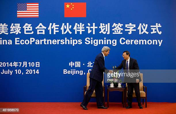S Secretary of State John Kerry shakes hands with Chinese State Council Yang Jiechi as they arrive for the ChinaUS EcoPartnerships signing ceremony...