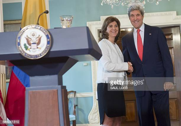 US Secretary of State John Kerry shakes hands with Colombian Foreign Minister Maria Angela Holguin following a press conference at the State...