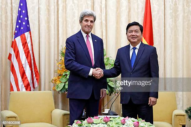US Secretary of State John Kerry shakes hands with Secretary of the Ho Chi Minh City Party Committee Dinh La Thang before their meeting in Ho Chi...