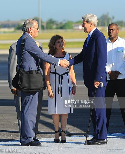US Secretary of State John Kerry shakes hands with the Chief of Mission at the US Embassy in Havana Jeffrey DeLaurentis upon his arrival at Jose...
