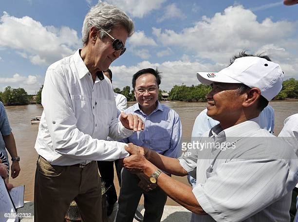 Secretary of State John Kerry shakes hands with Vo Ban Tam who was a member of the former Viet Cong and who took part in the attack on Kerry's Swift...