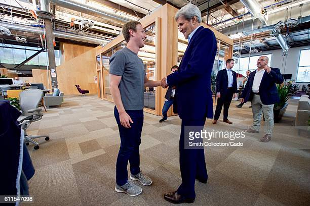 US Secretary of State John Kerry shaking hands with Facebook CEO Mark Zuckerberg at Facebook headquarters Menlo Park California June 23 2016 Image...