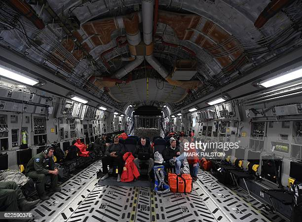 Secretary of State John Kerry sits onboard a US Air Force C17 Globemaster as it leaves the McMurdo station in Antarctica for New Zealand on November...