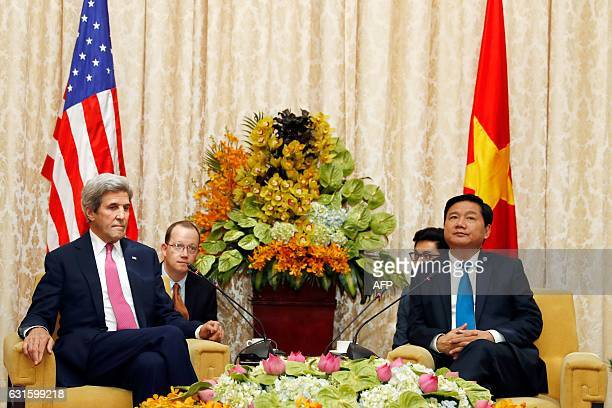 US Secretary of State John Kerry sits with Secretary of the Ho Chi Minh City Party Committee Dinh La Thang during their meeting in Ho Chi Minh City...