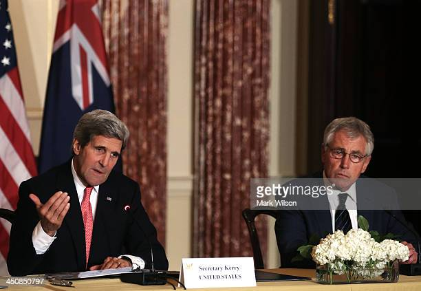 Secretary of State John Kerry , speaks about Afghanistan while Defense Secretary Chuck Hagel listens during a news conference at the State...