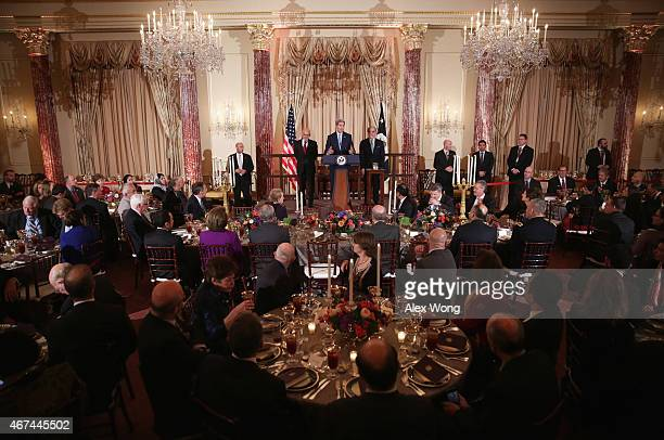 Secretary of State John Kerry speaks as Afghanistan President Ashraf Ghani and Afghanistan Chief Executie Abdullah Abdullah listen as they make...
