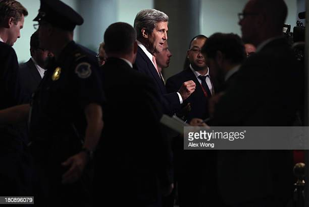 S Secretary of State John Kerry speaks to members of the media as he arrives for a closed briefing on Syria before the Senate Foreign Relations...