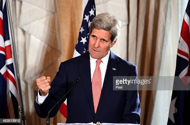Secretary of State John Kerry speaks to the media during a press conference at the conclusion of the AUSMIN talks at Admiralty House on August 12,...