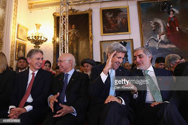Secretary of State John Kerry speaks with Abdullah Abdullah Chief Executive Officer of Afghanistan during the London Conference on Afghanistan on...