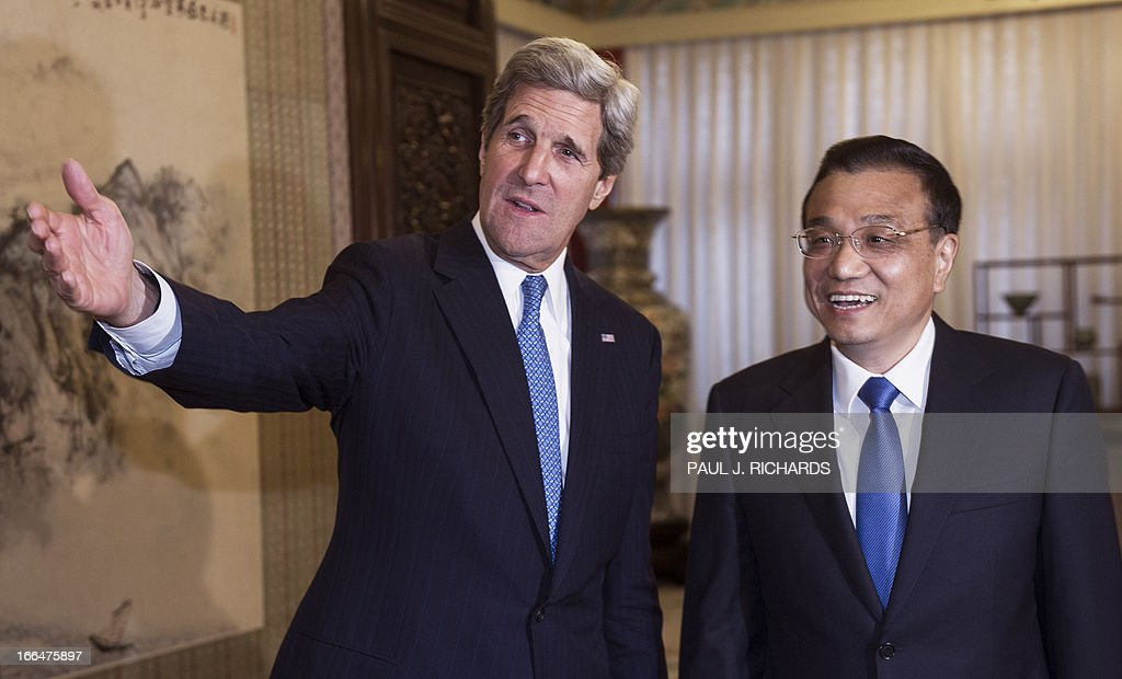 US Secretary of State John Kerry (L) speaks with China's Premier Li Keqiang (R) during a meeting at the Zhongnanhai compound in Beijing on April 13, 2013. The current situation on the Korean peninsula is at a 'critical time', US Secretary of State John Kerry told Chinese President Xi Jinping on April 13 as he arrived to seek Beijing's intervention in the crisis. AFP PHOTO / POOL / Paul J. Richards