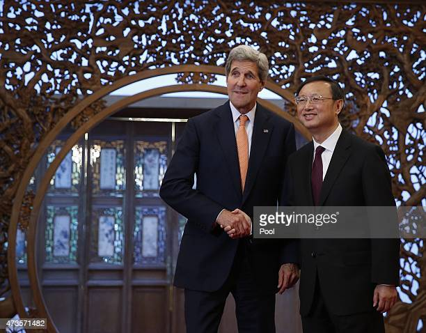 S Secretary of State John Kerry speaks with China's State Councilor Yang Jiechi at the Diaoyutai State Guest House on May 16 2015 in Beijing China US...