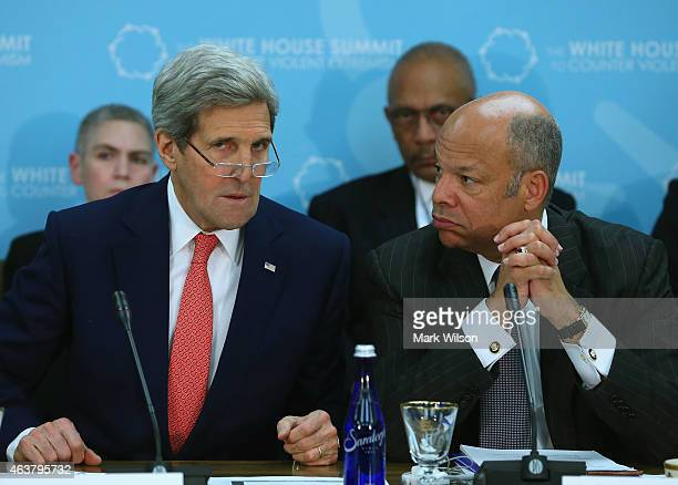 Secretary of State John Kerry speaks with Homeland Security Secretary Jeh Johnson during a counter terrorism summit February 18 2015 in Washington DC...