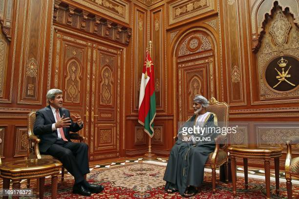 US Secretary of State John Kerry speaks with Oman's Sultan Qaboos bin Said during a meeting at Bait alBaraka in Muscat on May 21 2013 Kerry arrived...